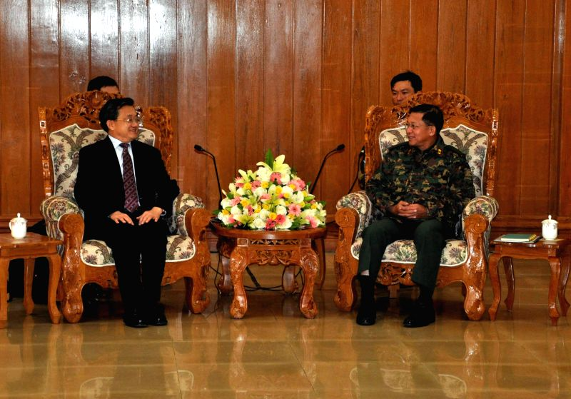 Liu Zhenmin (L), Chinese deputy foreign minister and government special envoy, meets with Min Aung Hlaing, commander-in-chief of Myanmar's Defense Services, in ...
