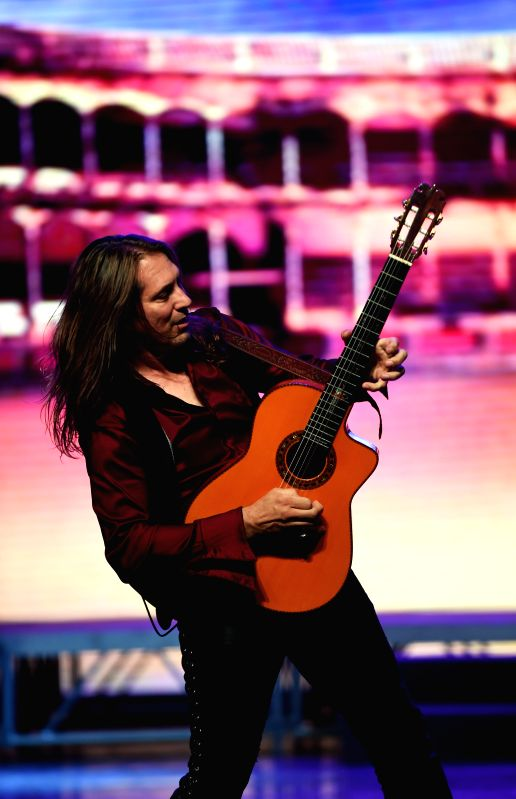 Emmy Award winner Spanish guitarist Roni Benise (C) performs at the art center in Liuzhou, southwest China's Guangxi Zhuang Autonomous Region, April 28, 2015. A ...