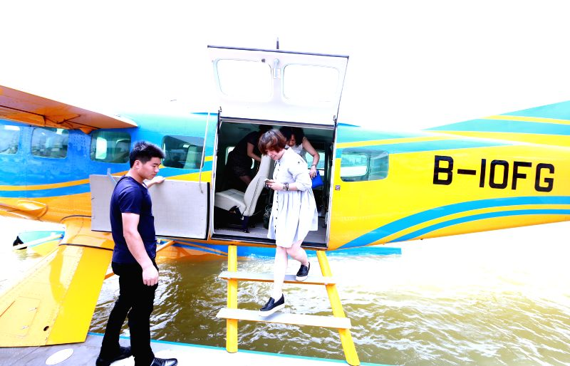 LIUZHOU, May 27, 2016 - Visitors get off an aquatic plane after sightseeing at the Jinglan aquatic base in Liuzhou City, south China's Guangxi Zhuang Autonomous Region, May 26, 2016. Liuzhou has ...