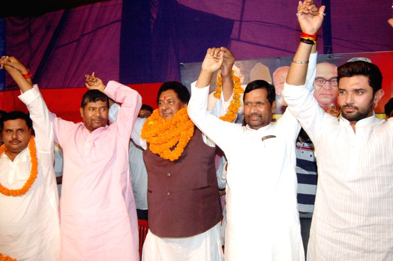 LJP chief and Union Minister for Consumer Affairs, Food and Public Distribution Ramvilas Paswan, party leader Chirag Paswan and others during a party programme in Patna on Aug 19, 2014.