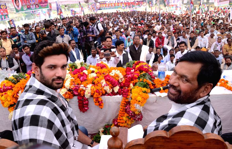 LJP chief and Union Minister for Consumer Affairs, Food and Public Distribution Ramvilas Paswan with his son and party MP from Jamui, Chirag Paswan during a party programme in Lucknow, on Nov 18, ...