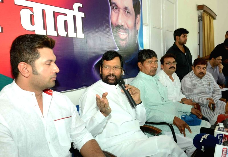 LJP chief and Union Minister for Consumer Affairs, Food and Public Distribution Ramvilas Paswan addresses a press conference in Patna, on May 22, 2016. Also seen party MP Chirag Paswan.
