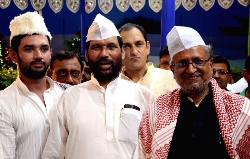 LJP leader Chirag Paswan and Union Minister for Consumer Affairs, Food and Public Distribution Ramvilas Paswan with BJP leaders Sushil Kumar Modi during an iftar party hosted by Paswan in Patna on ... - Sushil Kumar Modi