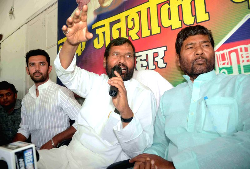 LJP supremo Ram Vilas Paswan with party leader Chirag Paswan and others during a press conference in Patna on May 17, 2014.