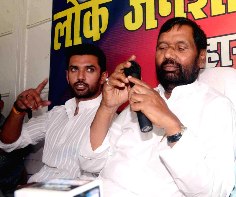 LJP supremo Ram Vilas Paswan with party leader Chirag Paswan during a press conference in Patna on May 17, 2014.