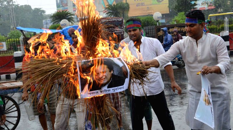 LJP workers burn an effigy of Pakistan Prime Minister Nawaz Sharif during a protest rally in Patna on July 18, 2016. - Nawaz Sharif