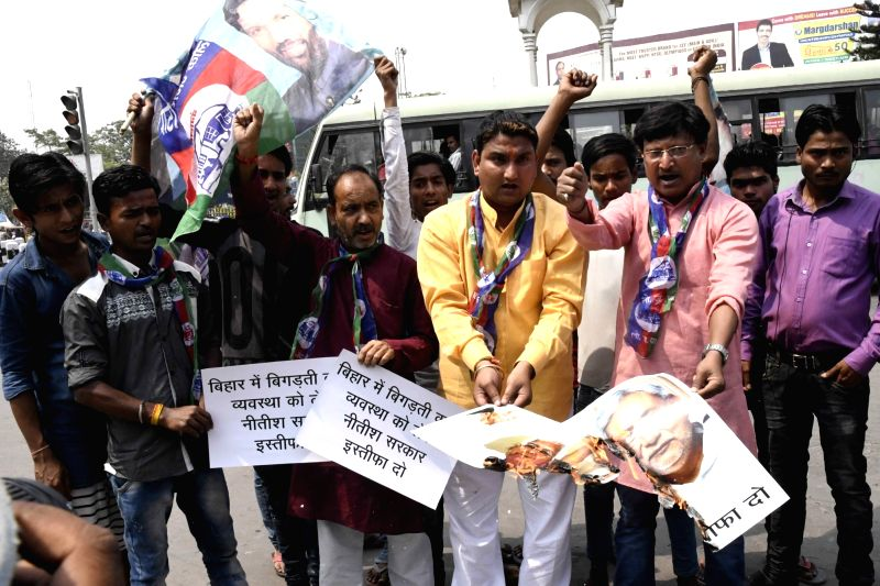 LJP workers stage a demonstration against deteriorating law and order situation in Patna on April 18, 2017.