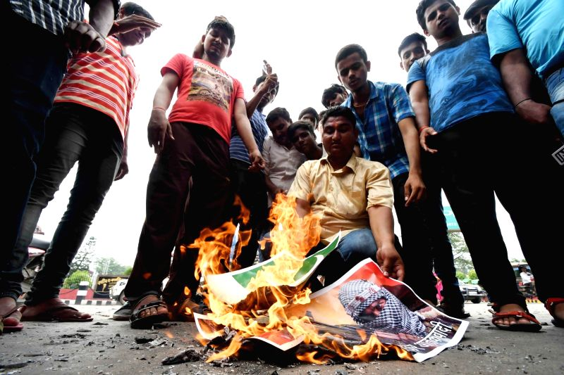 LJP workers stage a demonstration against attack on Amarnath pilgrims, in Patna on July 11, 2017.