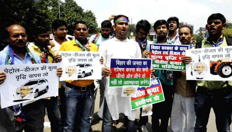LJP workers stage a demonstration against hike in against the Bihar government for the recent hikes in petrol and diesel prices in Patna on Aug 10, 2016.