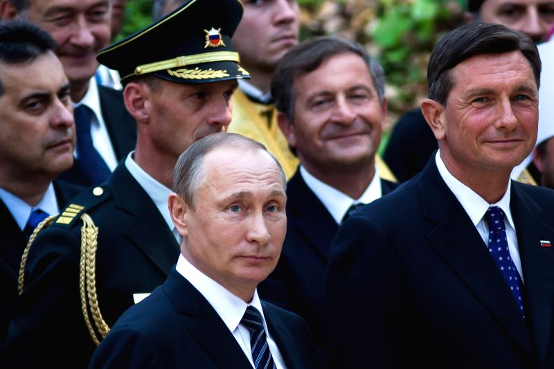LJUBLJANA, July 31, 2016 - Russian President Vladimir Putin (front L) and Slovenian President Borut Pahor (front R) attend the 100th anniversary of the Russian Chapel in Kranjska Gora, Slovenia, July ...