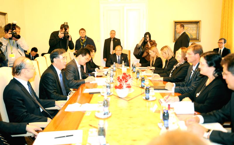 Ljubljana (Slovenia): Chinese Vice Premier Wang Yang (2nd L) meets with Slovenian Prime Minister Miro Cerar (3rd R) in Ljubljana, Slovenia, on Nov. 20, 2014.