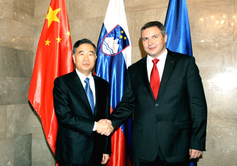 Ljubljana (Slovenia): Chinese Vice Premier Wang Yang (L) shakes hands with Slovenian Vice Premier and Minister of Agriculture, Forestry and Food Dejan Zidan in Ljubljana, Slovenia, on Nov. 20, 2014. .