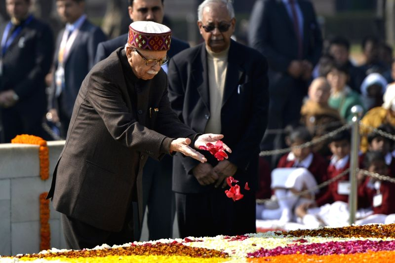 LK Advani paying tributes on death anniversary of Mahatma Gandhi Veteran BJP leader LK Advani paying tributes at the samadhi of Mahatma Gandhi on his death anniversary in New Delhi on Jan. ... - Gandhi Veteran B