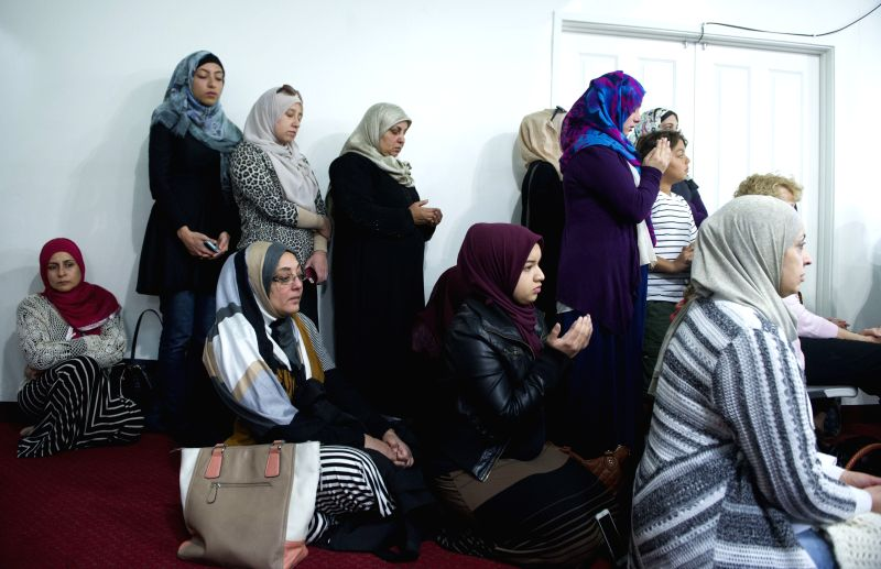 Local Muslim residents attend a gathering to mourn victims who were killed in the recent deadly shooting incident in Islamic Community Center in Loma Linda, ...