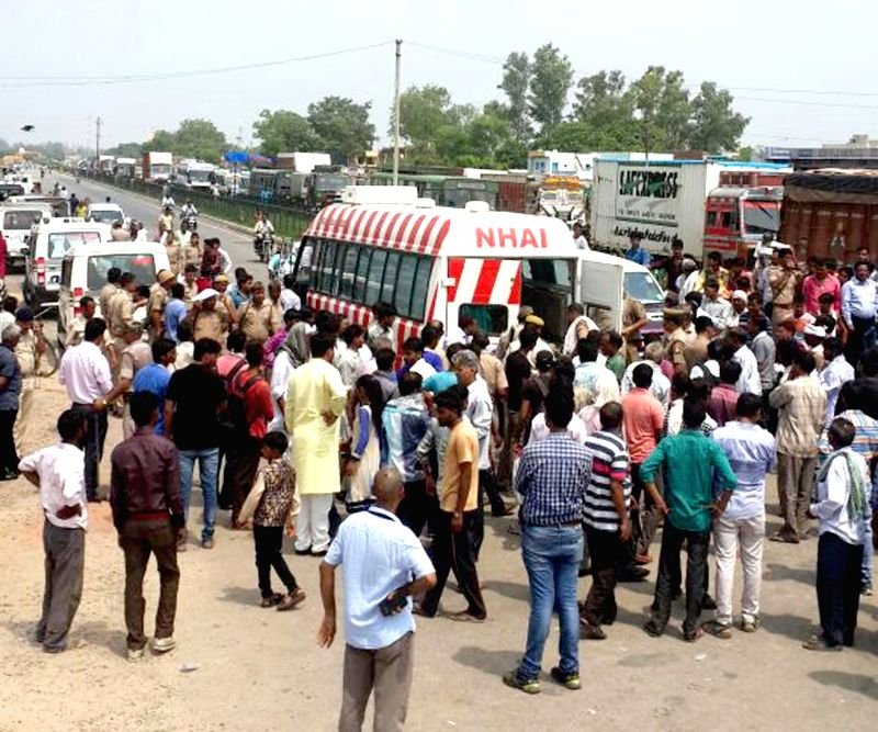 Locals block Agra-Delhi Highway (NH2) after a tractor hit by a speeding truck near Barari Village killing one and injuring others in Mathura on July 24, 2016.