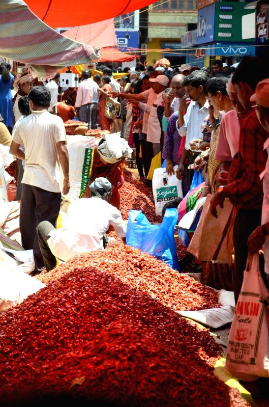 Locals throng a Mapusa market to buy chilies, salted fish (Khaarey), onions, brooms etc ahead of monsoon in on May 5, 2017. This practice of accumulating and gathering food items at home ...