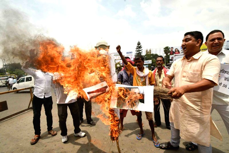 Lok Jan Shakti Party (LJP) workers stage a demonstration against Congress president Rahul Gandhi in the wake of the no confidence motion moved by the opposition during Parliament's Monsoon ... - Rahul Gandhi
