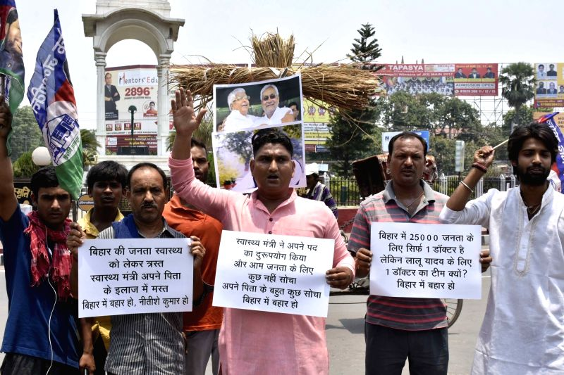 Lok Janshakti Party (LJP) workers stage a demonstration against Bihar Chief Minister Nitish Kumar, Health Minister Tej Pratap Yadav and RJD supremo Lalu Prasad Yadav in Patna on June 14, 2017. - Nitish Kumar, Tej Pratap Yadav and Lalu Prasad Yadav