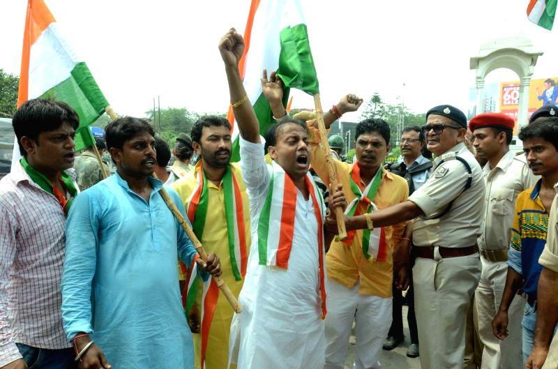 Lok Janshakti Party workers participate during Aman Yatra in Patna on July 24, 2016.