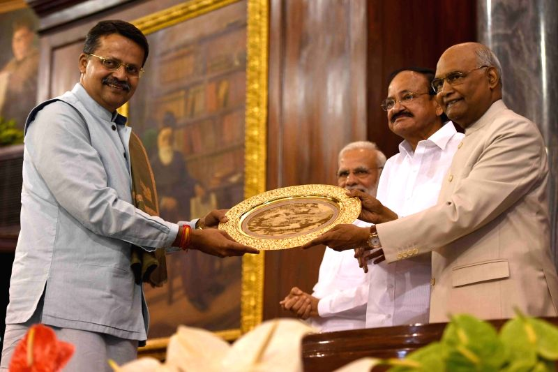 Lok Sabha MP Bhartruhari Mahtab of the BJD receives Outstanding Parliamentarian Award for the year 2014 from President Ram Nath Kovind during Outstanding Parliamentarian Award ceremony at ... - Nath Kovind