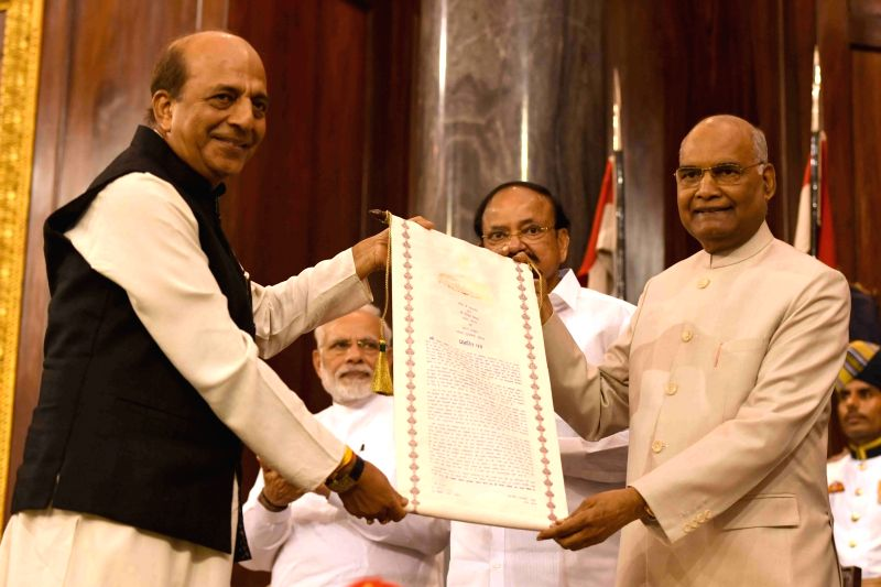 Lok Sabha MP Dinesh Trivedi of the Trinamool Congress receives Outstanding Parliamentarian Award for the year 2016 from President Ram Nath Kovind during Outstanding Parliamentarian Award ... - Nath Kovind