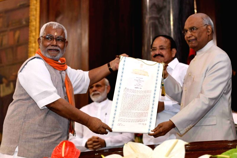 Lok Sabha MP Hukmdev Narayan Yadav of the BJP receives Outstanding Parliamentarian Award for the year 2014 from President Ram Nath Kovind during Outstanding Parliamentarian Award ceremony ... - Hukmdev Narayan Yadav and Nath Kovind