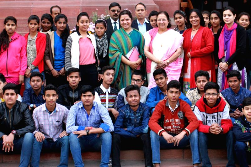 Lok Sabha Speaker Sumitra Mahajan in a group photo with school students at the Parliament in New Delhi, on Dec 8, 2015.