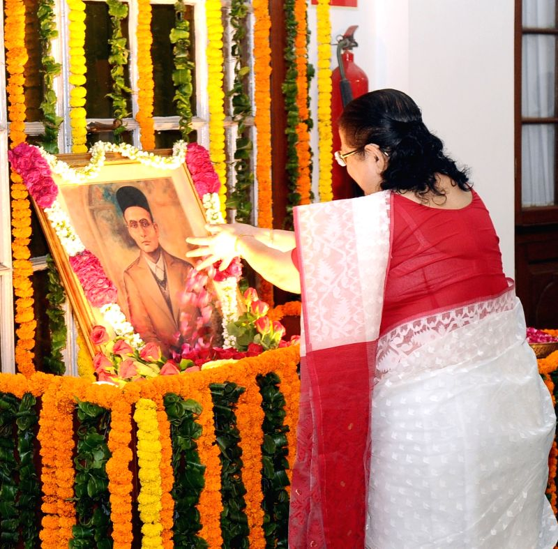 Lok Sabha Speaker Sumitra Mahajan pays floral tributes at the portrait of Swatantryaveer Vinayak Damodar Savarkar, on his his birth anniversary, at Parliament House, in New Delhi on May ... - Sumitra Mahajan
