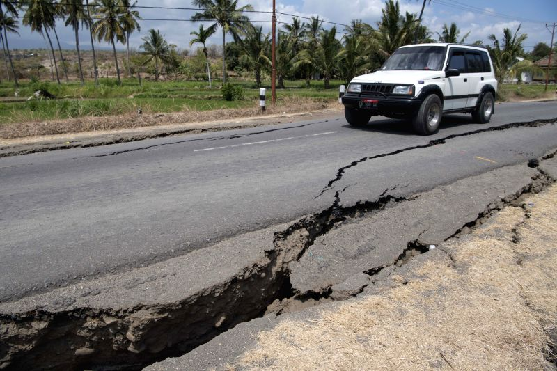 LOMBOK, Aug. 9, 2018 - Photo taken on Aug. 9, 2018 shows a damaged road in Lombok island, Indonesia. A 5.9-magnitude aftershock struck Lombok island in central Indonesia on Thursday four days after a ...