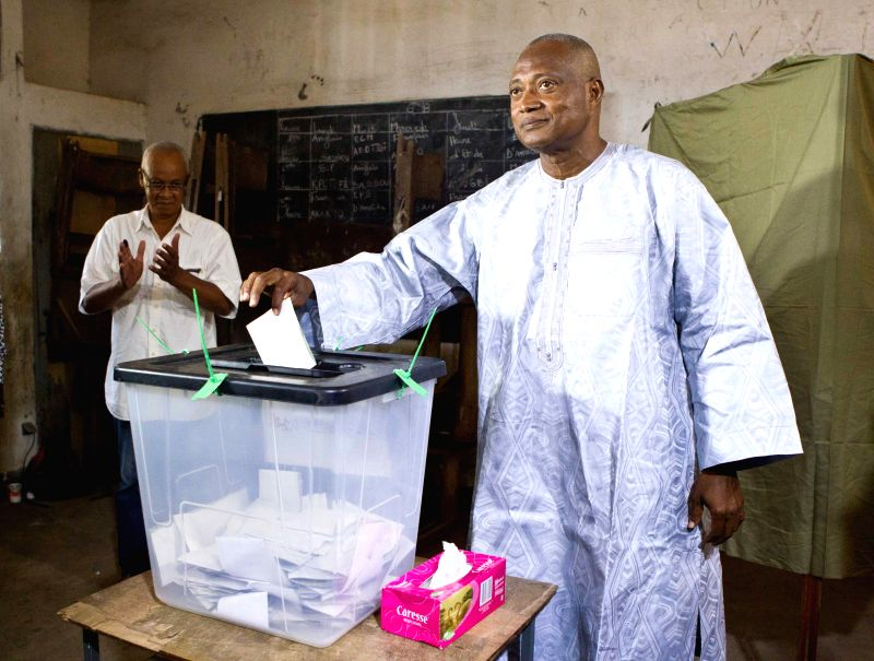 Togo's Opposition leader and candidate for Alliance for National Change (ANC) Jean-Pierre Fabre casts his ballot at a polling station in Lome, Togo, April 25, 2015. ...