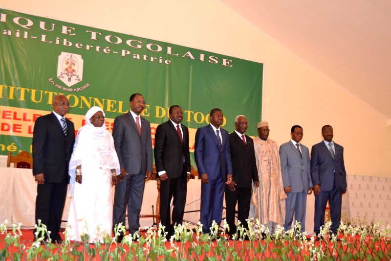 Togo's President Faure Gnassingbe(C) poses for photos with Togolese ministers during the swearing-in ceremony in Lome, Togo, on May 4, 2015. Togo's President Faure ...