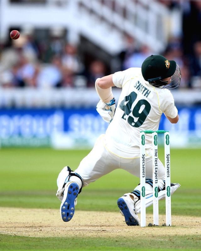 London: A rocket Jofra Archer bouncer clattered Steve Smith down flat on his face, cutting short a masterclass knock as the ace batsman was forced to retire after lunch on Day 4 of the rain-affected second Ashes Test at Lord's on Aug 17, 2019. (Photo