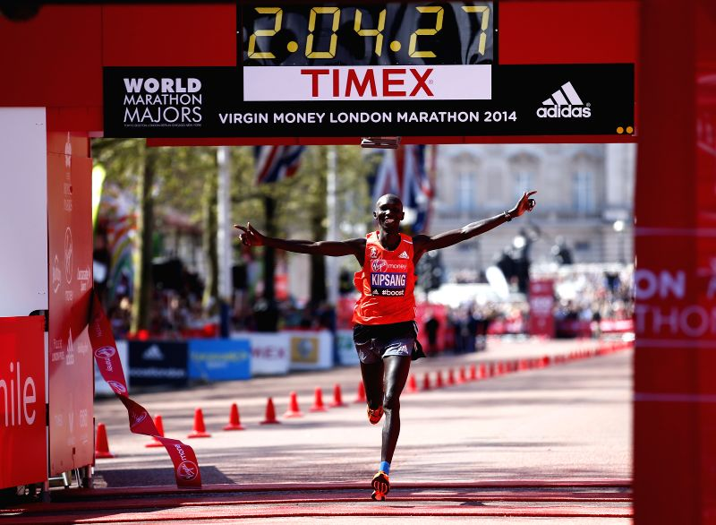 Wilson Kipsang of Kenya celebrates after crossing the finish line of 2014 London Marathon in London, Britain on April 13, 2014. Wilson Kipsang claimed the title of ..