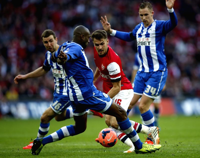 Aaron Ramsey(2nd, R) of Arsenal breaks through during FA Cup semifinal match between Arsenal and Wigan Athletic at Wembley Stadium in London, Britain, on April 12, .