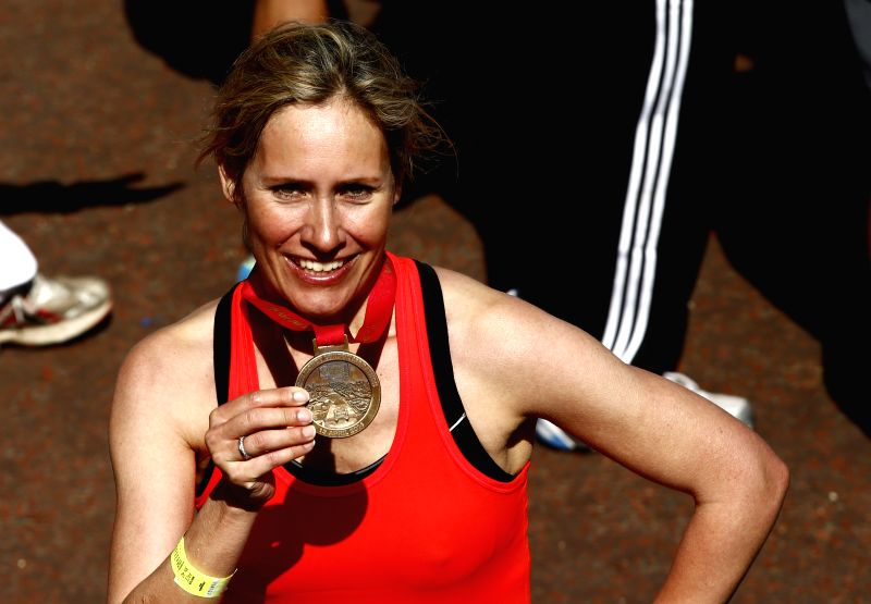 BBC news presenter Sophie Raworth poses after crossing the finish line of 2014 London Marathon in London, Britain on Apr. 13, 2014. Sophie Raworth finished the run .