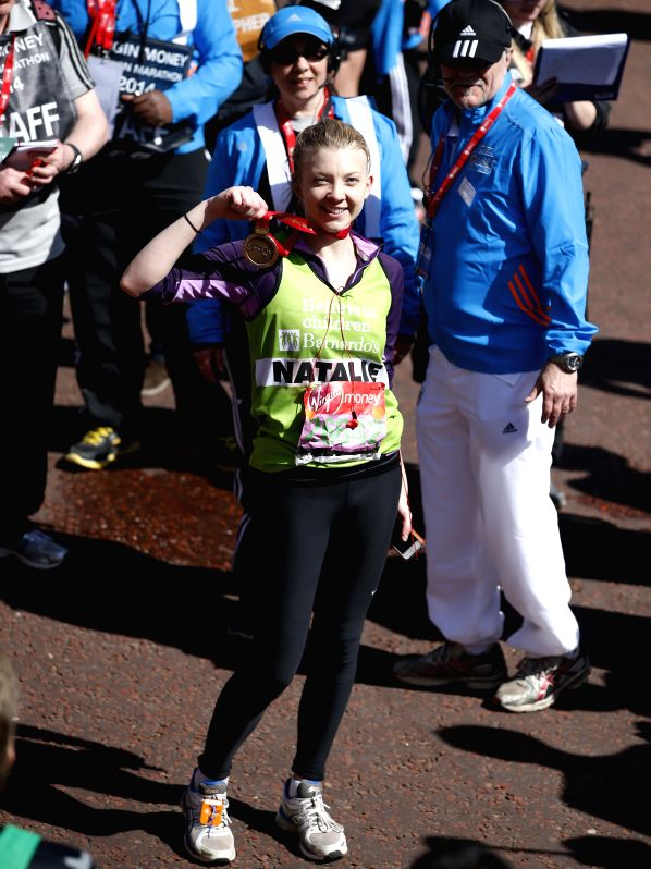English actress Natalie Dormer poses after crossing the finish line of 2014 London Marathon in London, Britain on Apr. 13, 2014. Natalie Dormer finished the run in . - Natalie Dormer