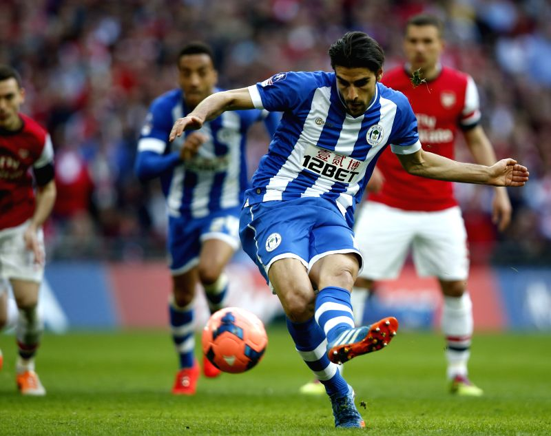 Jordi Gomez of Wigan Athletic scores via a penalty during FA Cup semifinal match between Arsenal and Wigan Athletic at Wembley Stadium in London, Britain, on April .