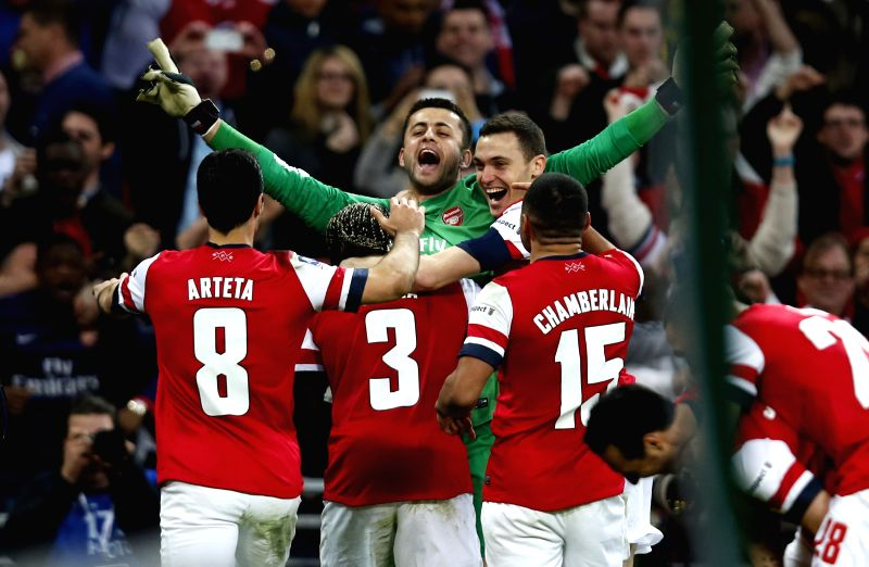 Lukasz Fabianski (Top), goalie of Arsenal, celebrates victory with teammates after FA Cup semifinal match between Arsenal and Wigan Athletic at Wembley Stadium in ..