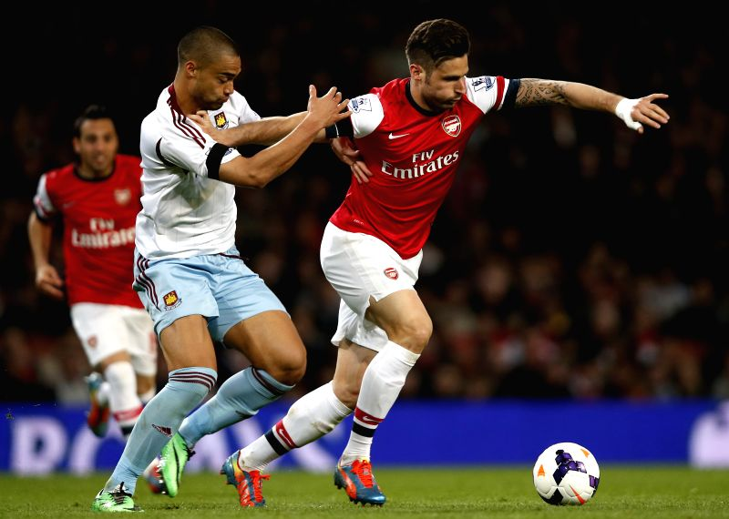 Olivier Giroud (R) of Arsenal vies with Winston Reid of West Ham United during the Barclays Premier League match between Arsenal and West Ham United at Emirates ...