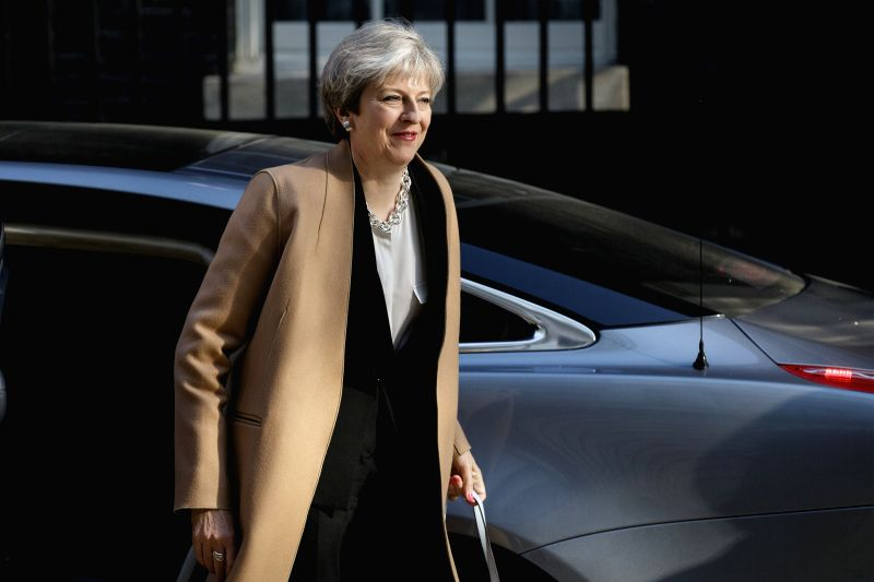 LONDON, April 19, 2017 - British Prime Minister Theresa May arrives back at 10 Downing Street after appearing on BBC Radio 4 this morning in London, Britain on April 19, 2017. British Prime Minister ... - Theresa May