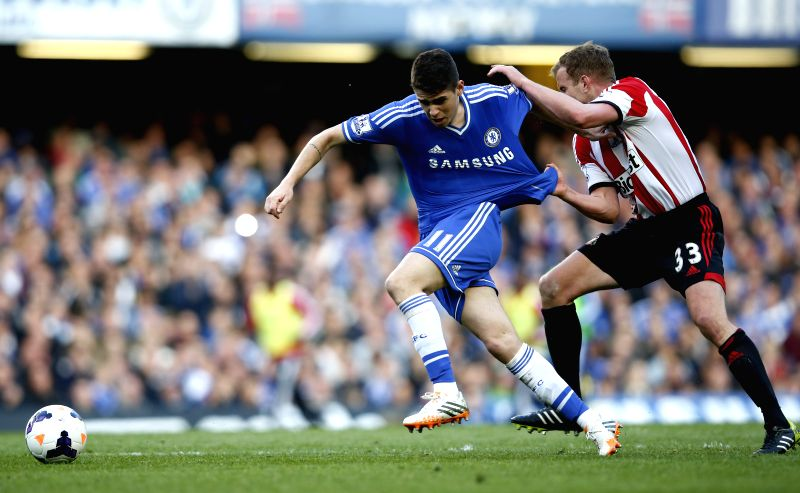Oscar(C) of Chelsea vies with  John O'Shea (L) of Sunderland during the Barclays Premier League match between Chelsea and Sunderland at Stamford Stadium in London, .