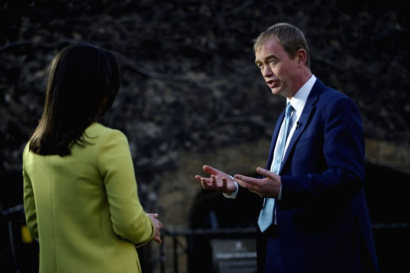 LONDON, April 20, 2017 - er of the Liberal Democrats Tim Farron (R) speaks with media outside the houses of Parliament in London, Britain, on April 19, 2017. Members of Parliament in the British ... - Theresa M