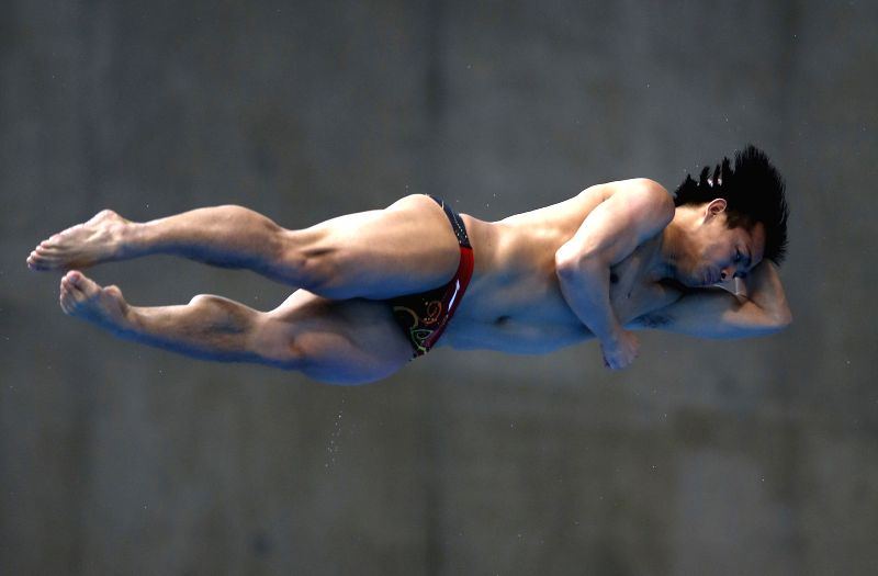 He Chong of China competes during the final of Men's 3M Springboard of FINA/NVC Diving World Series 2014 at the London Aquatics Centre in London, Britain, April ...