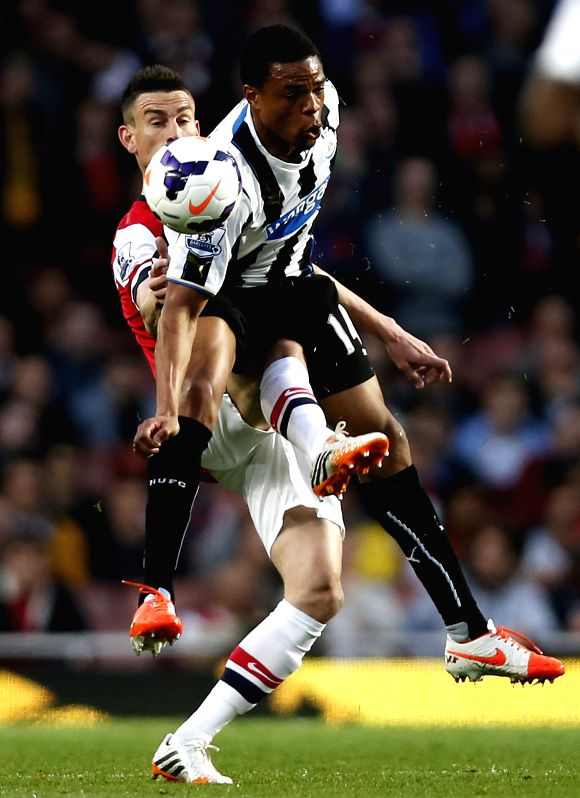 Laurent Koscielny (L) of Arsenal vies with Loic Remy of Newcastle during the Barclays Premier League match between Arsenal and Newcastle at Emirates Stadium in ...