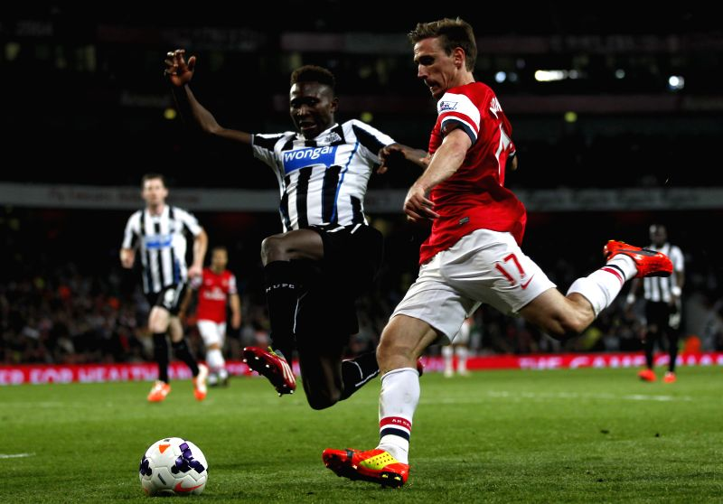 Nacho Monreal (R) of Arsenal vies with Mapou Yanga-Mbiwa of Newcastle during the Barclays Premier League match between Arsenal and Newcastle at Emirates Stadium in .