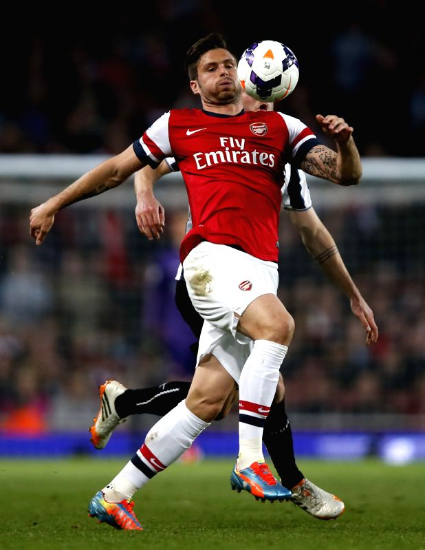 Olivier Giroud(Front) of Arsenal controls the ball during the Barclays Premier League match between Arsenal and Newcastle at Emirates Stadium in London, Britain on .
