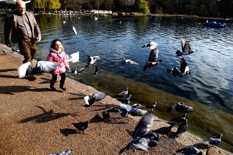 People enjoy themselves in central London, Britain on April 7, 2015.