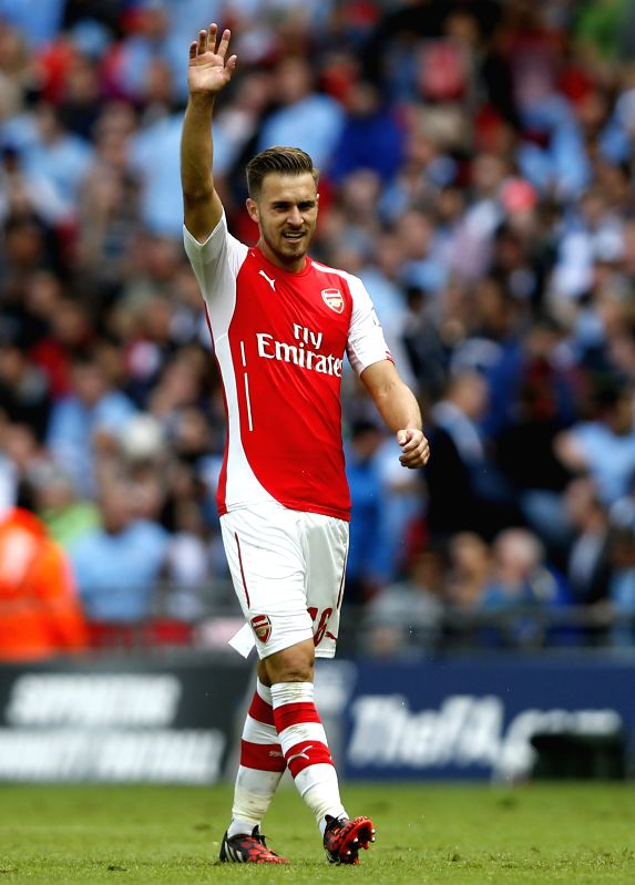 Aaron Ramsey of Arsenal celebrates scoring during the Community Shield match between Arsenal and Manchester City  at Wembley Stadium in London, Britain on Aug. 10, ..