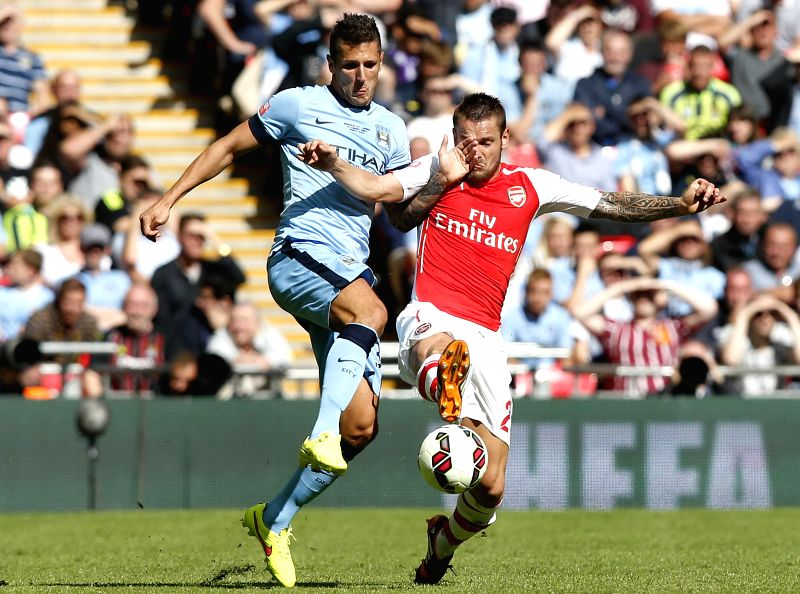Mathieu Debuchy(R) of Arsenal vies with Stevan Jovetic of Manchester City during the Community Shield match between Arsenal and Manchester City at Wembley Stadium in