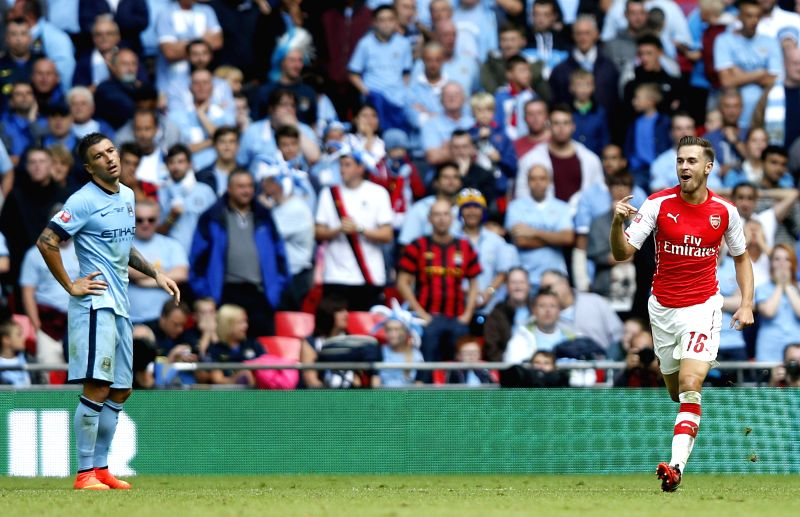 Aaron Ramsey (R) of Arsenal celebrates scoring during the Community Shield match between Arsenal and Manchester City  at Wembley Stadium in London, Britain on Aug. ..
